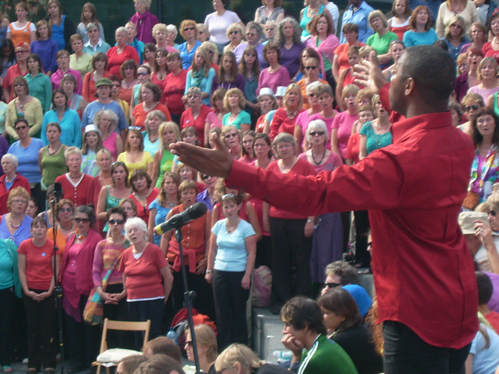 Michael Harper conducting SING FOR WATER at Thames Festival